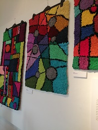 textile on wall of recycle exhibition