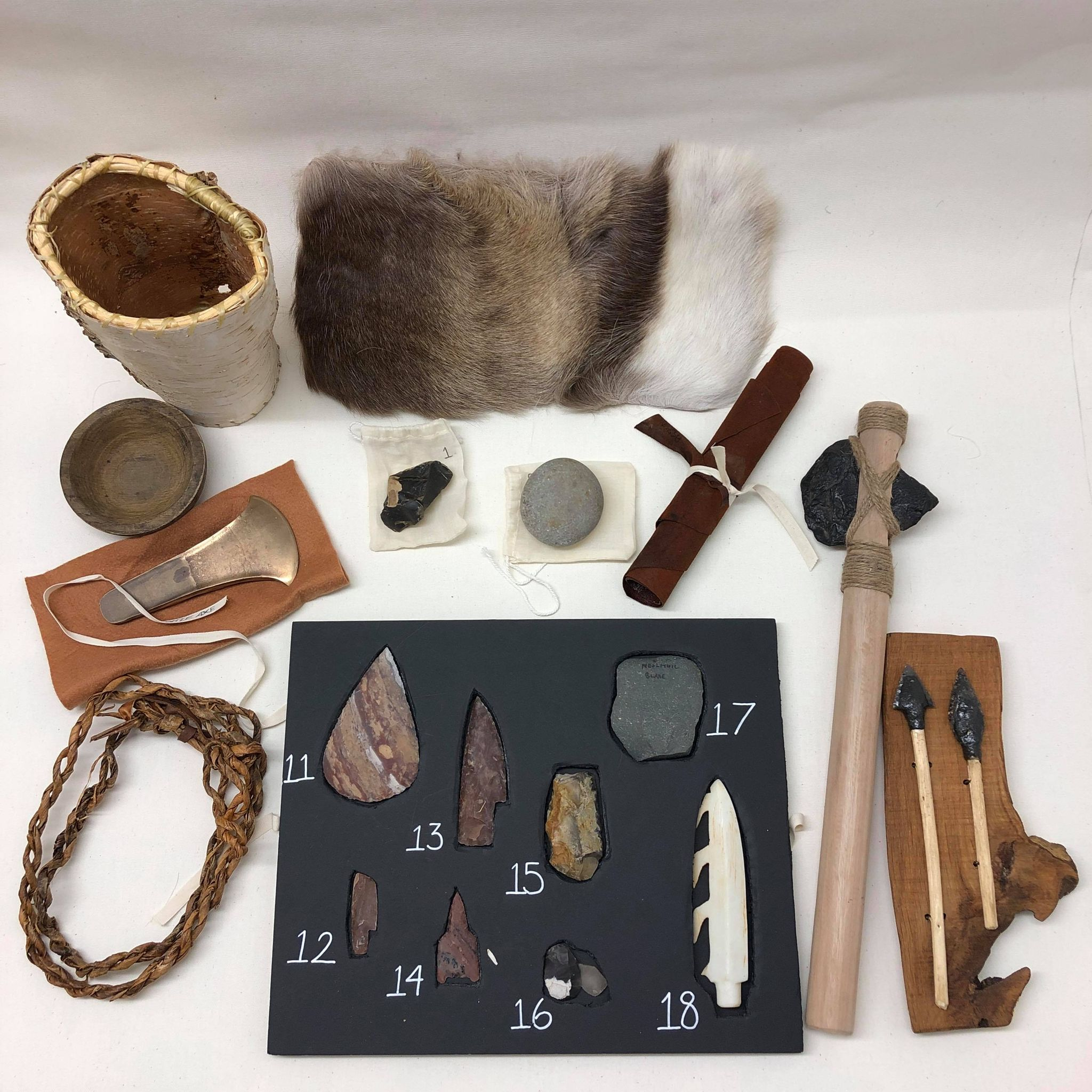 Stone Age box items contents flints weapons furs