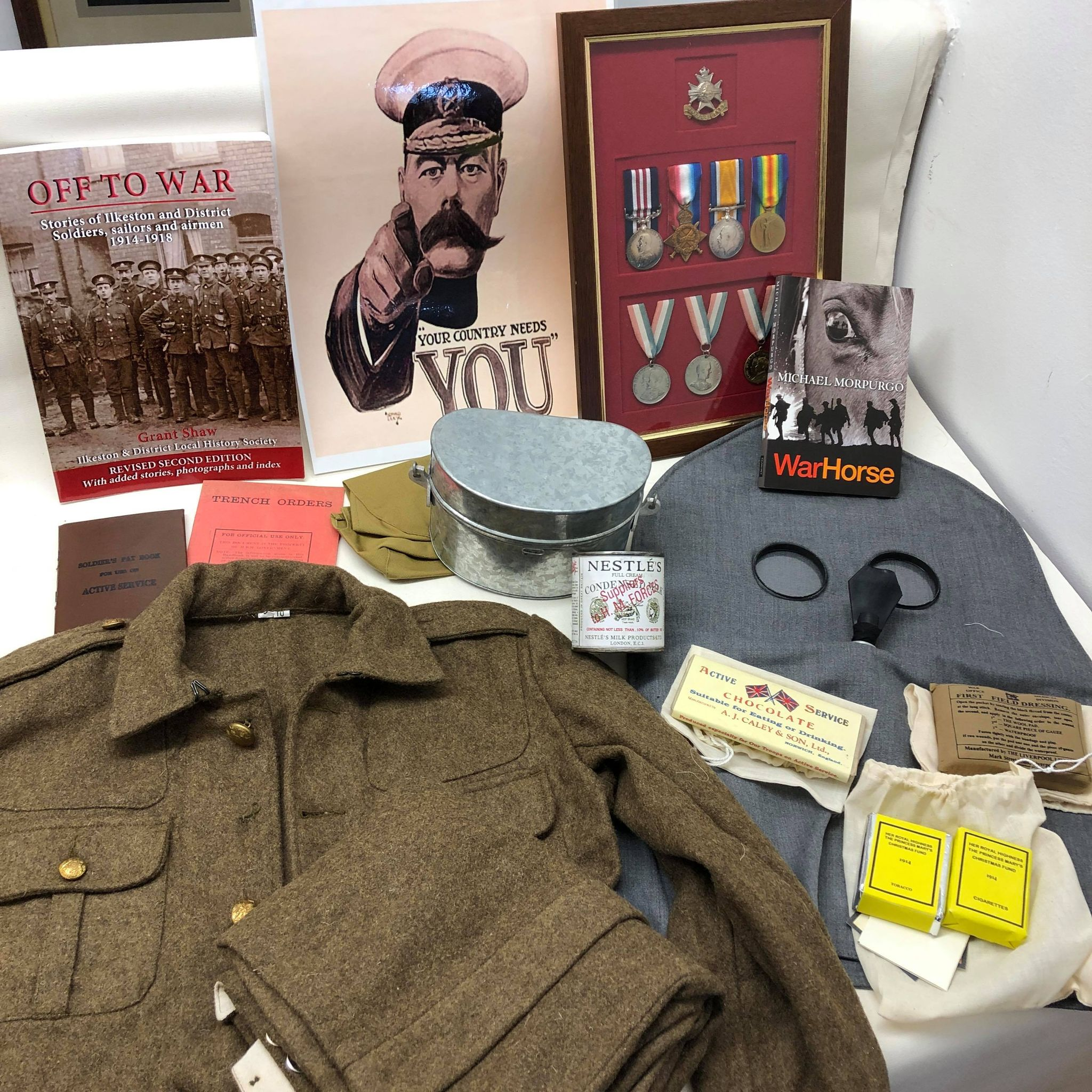 world war one box items medals uniforms and books