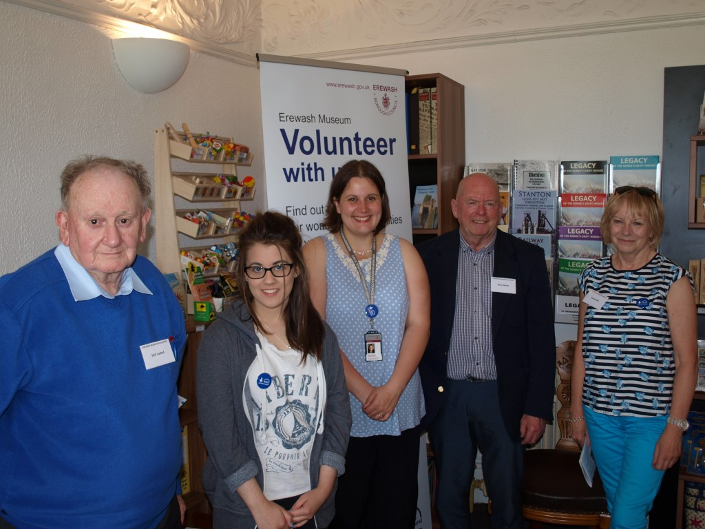 Volunteers stand in group at volunteering event