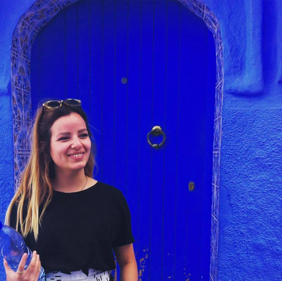 Ellie in front of blue door